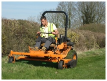 Man on mower to illustrate machinery hire day rate package from Marcus Young Landscapes Ltd