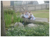 Children in school play area  - schools grounds maintenance by Marcus Young Landscapes Ltd